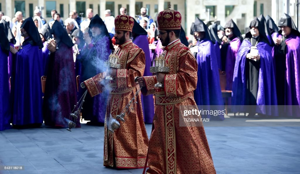 Priests attend the Divine Liturgy by Catholicos of All Armenians Karekin II and Pope Francis (both not pictured) at the Apostolic Cathedral in Etchmiadzin, outside Yerevan, on June 26, 2016. / AFP / TIZIANA