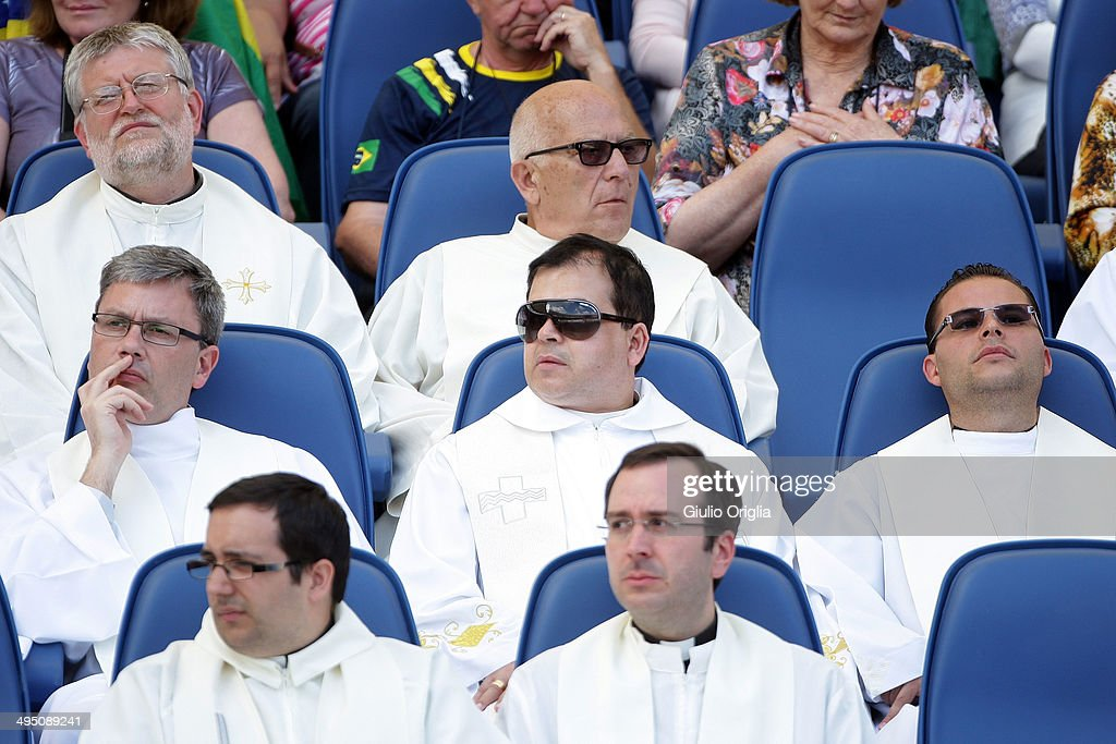 Priests attend the meeting between Pope Francis and the Movement of the Holy Spirit Renewal at the Olympic Stadium on June 1, 2014 in Rome, Italy. It is the first ever papal visit to a stadium in the Italian capital. This celebration of faith, organised by the Renewal in the Spirit, has been attended by representatives of more than fifty countries and has involved moments of prayer, music and an address by the Holy Father.