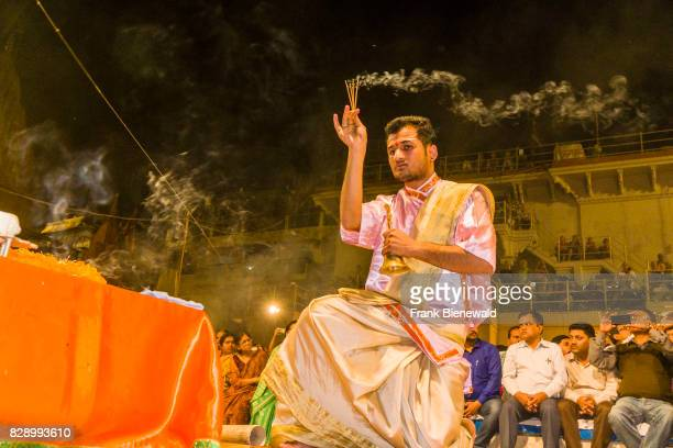 Priests Brahmins are performing Aartii a religious ceremony every evening at Dashashwamedh Ghat Main Ghat in the suburb Godowlia