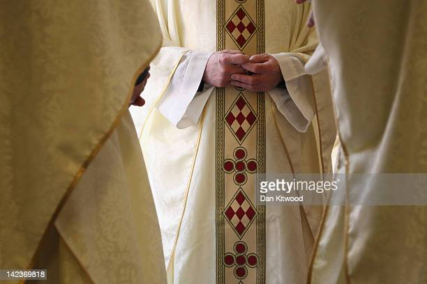 Priests gather wearing their new clerical vestments ahead of the annual Chrism Mass in Westminster Cathedral on April 3 2012 in London England The...
