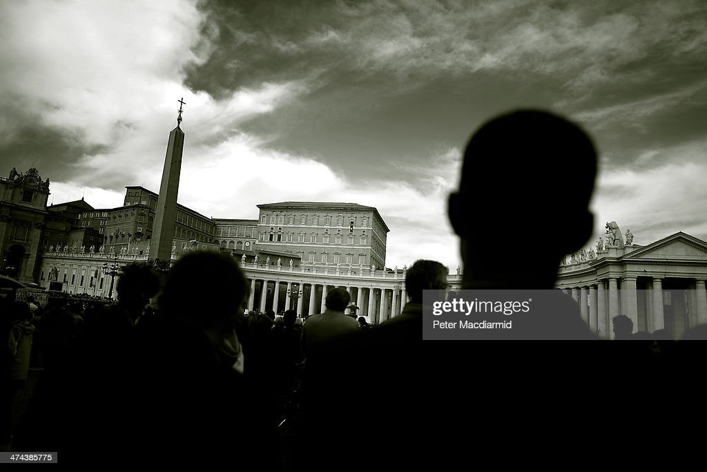 Priests in St Peter's Square watch as Pope Francis gives the Angelus blessing on February 23, 2014 in Vatican City, Vatican. Pope Francis created 19 new cardinals yesterday in a ceremony in St Peter's Basilica.
