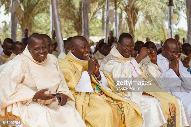Priests of the Very Holy Church of Jesus Christ of Baname attend at the Nazareth church in Djidja on February 25 2017 at the beginning of a service...