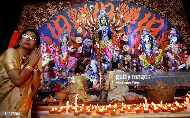 Priests performing rituals in front of an idol of the Hindu Goddess Durga during the Durga pooja festival at Navapalli Puja Samiti on October 12 2013...