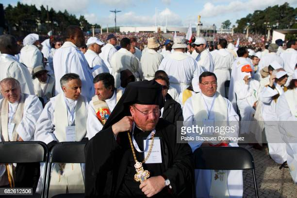 Priests wait for the start of the ceremony of canonization at the Sanctuary of Fatima on May 13 2017 in Fatima Portugal Pope Francis is attending the...