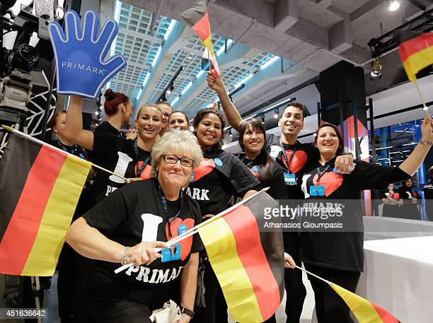 Primark staff wave German flags at the opening of the new Primark store at Alexanderplatz on July 03 2014 in Berlin Germany The Irish fashion label...