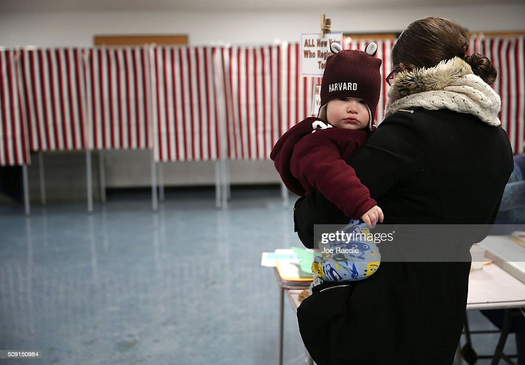 Primary day voter Alexandria Varney holds her son Austin Varney, 15mths old, as she checks in to vote at a polling station setup in the First Baptist Church on February 9, 2016 in Nashua, New Hampshire. Voters throughout the state are heading to the polls as the New Hampshire Primary, also known as the first-in-the-nation primary, continues the process of selecting the next president of the United States.