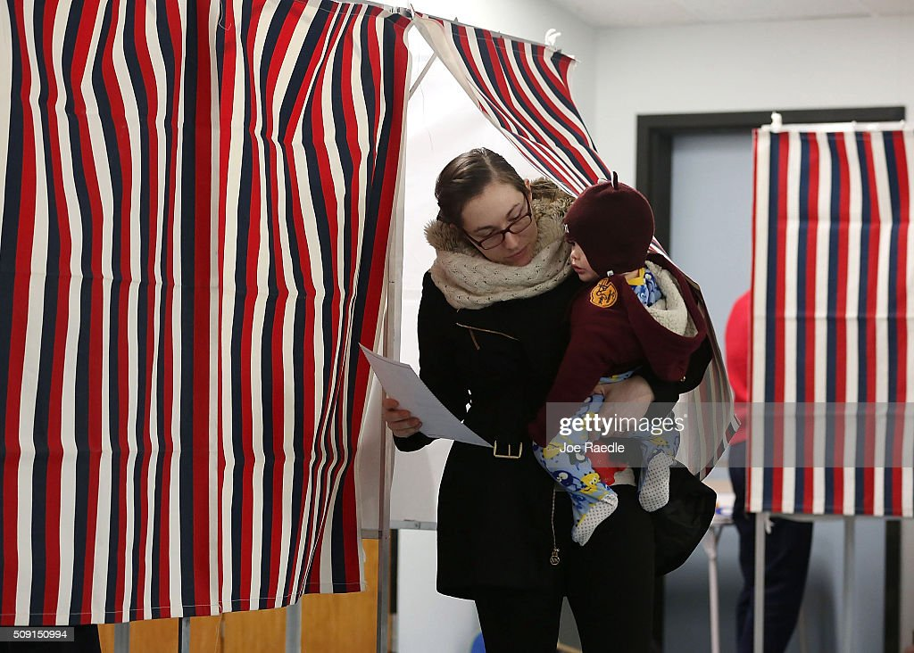 Primary day voter Alexandria Varney holds her son Austin Varney, 15mths old, as she exits a voting booth at a polling station setup in the First Baptist Church on February 9, 2016 in Nashua, New Hampshire. Voters throughout the state are heading to the polls as the New Hampshire Primary, also known as the first-in-the-nation primary, continues the process of selecting the next president of the United States.