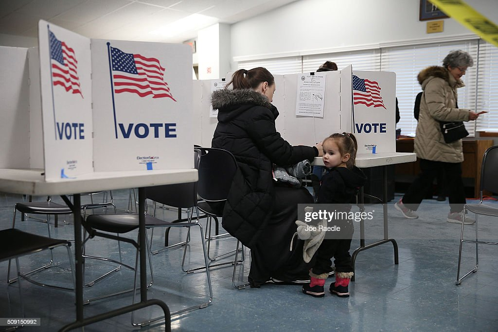 Primary day voter Amanda Binette fills out her ballot as her daughter, Emmaline Binette, 2 years old, stands next to her at a polling station setup in the First Baptist Church on February 9, 2016 in Nashua, New Hampshire. Voters throughout the state are heading to the polls as the New Hampshire Primary, also known as the first-in-the-nation primary, continues the process of selecting the next president of the United States.