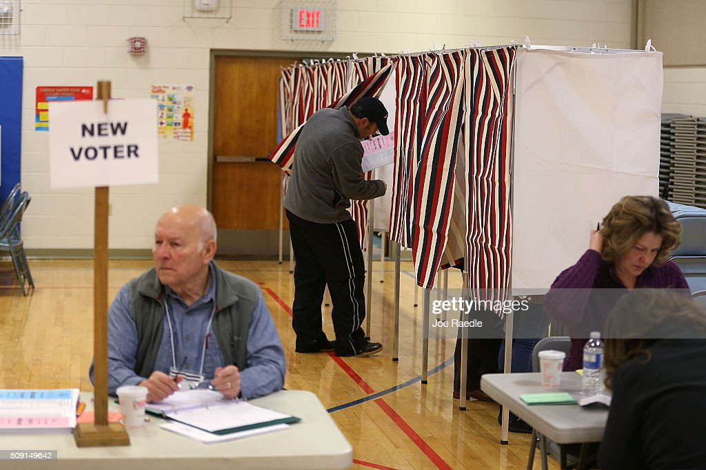 A primary day voter enters a voting booth at the Broad Street Elementary School polling station on February 9, 2016 in Nashua, New Hampshire. Voters throughout the state are heading to the polls as the New Hampshire Primary, also known as the first-in-the-nation primary, continues the process of selecting the next president of the United States.