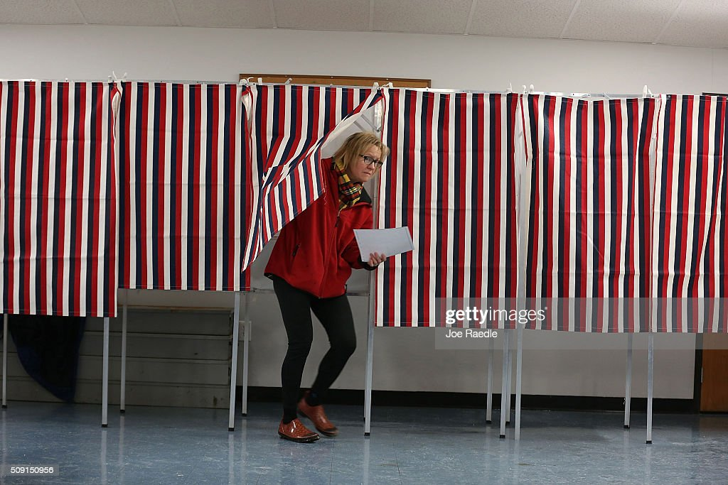 Primary day voter Jane Martin exits a voting booth as she casts her vote in a polling station setup in the First Baptist Church on February 9, 2016 in Nashua, New Hampshire. Voters throughout the state are heading to the polls as the New Hampshire Primary, also known as the first-in-the-nation primary, continues the process of selecting the next president of the United States.