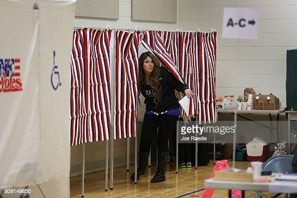 Primary day voter Michelle Blackui exits a voting booth at the Broad Street Elementary School polling station on February 9 2016 in Nashua New...