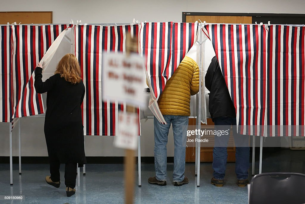 Primary day voters use voting booths as they cast their ballots at a polling station setup in the First Baptist Church on February 9, 2016 in Nashua, New Hampshire. Voters throughout the state are heading to the polls as the New Hampshire Primary, also known as the first-in-the-nation primary, continues the process of selecting the next president of the United States.