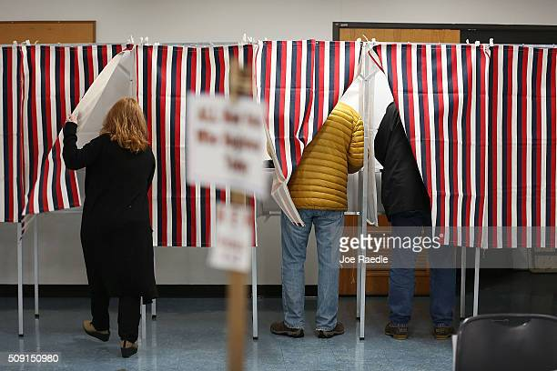 Primary day voters use voting booths as they cast their ballots at a polling station setup in the First Baptist Church on February 9 2016 in Nashua...
