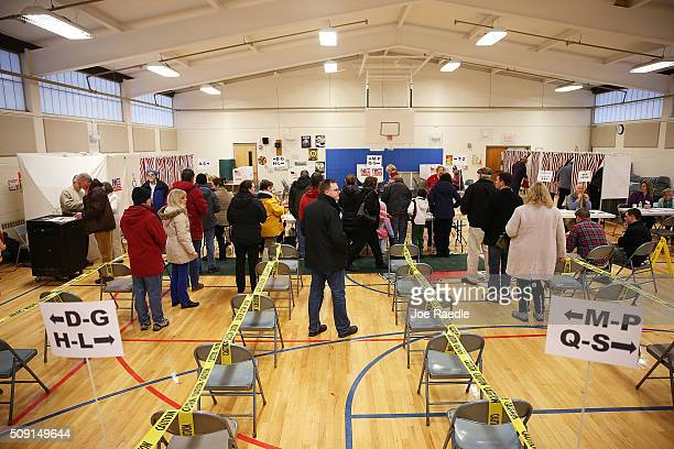 Primary day voters wait to cast their ballot at the Broad Street Elementary School polling station on February 9 2016 in Nashua New Hampshire Voters...