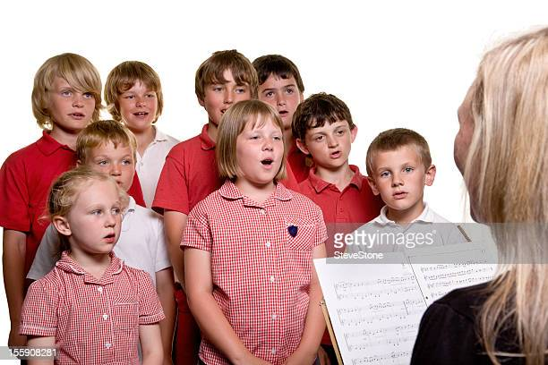 Primary school children in music lesson singing