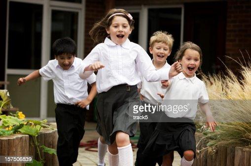 primary school: junior school children running out of their school