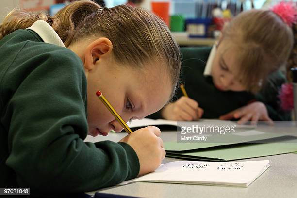 A primary school pupil at the Bridge Learning Campus completes her school work in a classroom at the school on February 24 2010 in Bristol England...