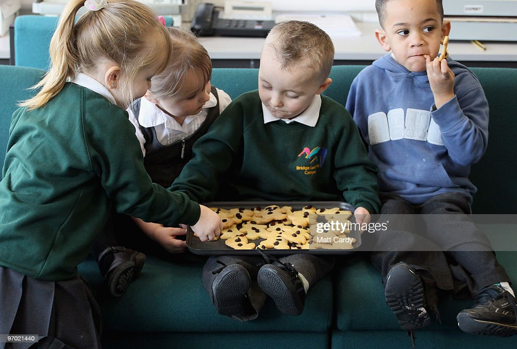 Primary school pupils at the Bridge Learning Campus share biscuits that they have just baked at the school on February 24, 2010 in Bristol, England. The 40million GBP campus in Hartcliffe, Bristol, was constructed as part of the Government's Building Schools for the Future programme and opened in January 2009. It now offers over 800 pupils a life long provision of learning from nursery, reception and primary to secondary and post-16 education. As the UK gears up for one of the most hotly contested general elections in recent history it is expected that that the economy, immigration, the NHS and education are likely to form the basis of many of the debates.