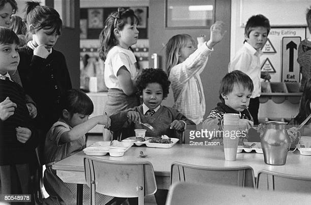 Primary school pupils in the dining hall of Hardwicke Parochial School in Herefordshire June 1987