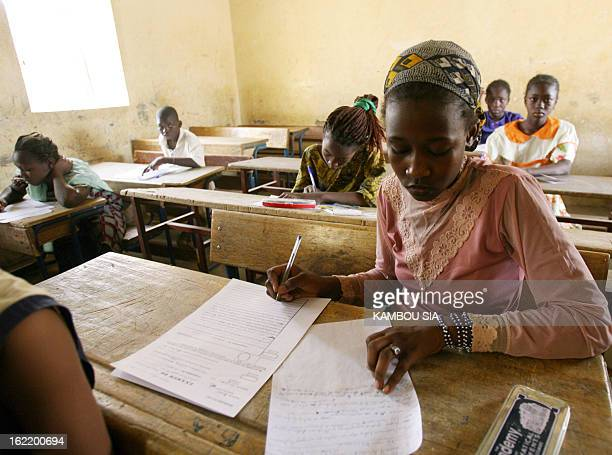 A primary school student passes an exam to enter junior high school 29 May 2006 at the Baye Ag Mahaha school in the northeastern Malian town of Kidal...