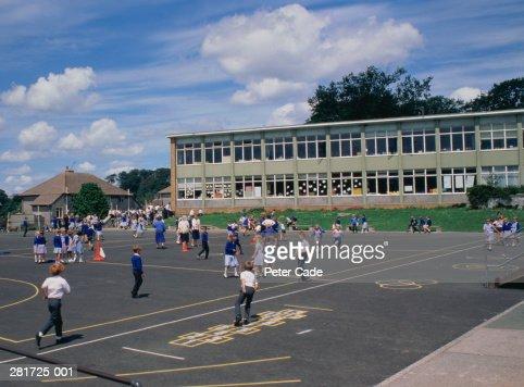 Primary school,children in blue uniform in playground : Stock Photo