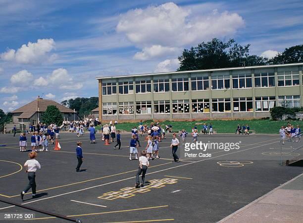 Primary school,children in blue uniform in playground