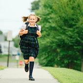 Primary Schoolgirl running to school