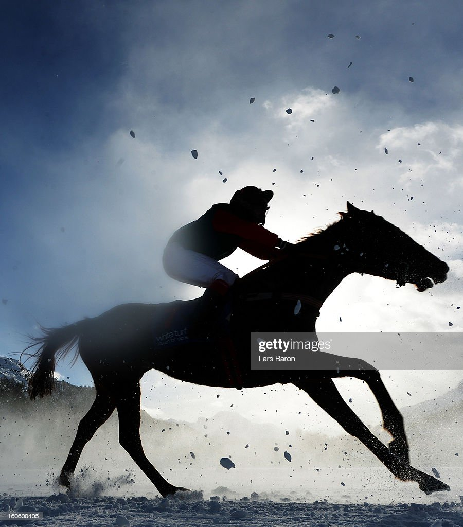 Primatist ridden by Lennart Hammer-Hansen competes during the Grand Prix Guardaval Immobilien race at the White Turf horse racing meeting held on the frozen Lake St Moritz on February 3, 2013 in St Moritz, Switzerland.