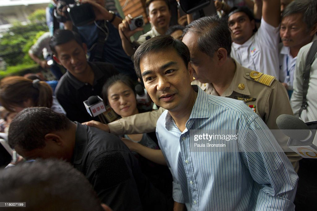 Prime Minister <a gi-track='captionPersonalityLinkClicked' href=/galleries/search?phrase=Abhisit+Vejjajiva&family=editorial&specificpeople=645779 ng-click='$event.stopPropagation()'>Abhisit Vejjajiva</a> is surrounded by the media after voting July 3rd, 2011 in Bangkok, Thailand as Thai's vote in the country's 4th election in 7 years. The vote pits Prime Minister <a gi-track='captionPersonalityLinkClicked' href=/galleries/search?phrase=Abhisit+Vejjajiva&family=editorial&specificpeople=645779 ng-click='$event.stopPropagation()'>Abhisit Vejjajiva</a>'s Democrat's against Thaksin's younger sister, Yingluck Shinawatra, who has the full support of the red shirt followers of fugitive former premier Thaksin Shinawatra, ousted in a 2006 coup.