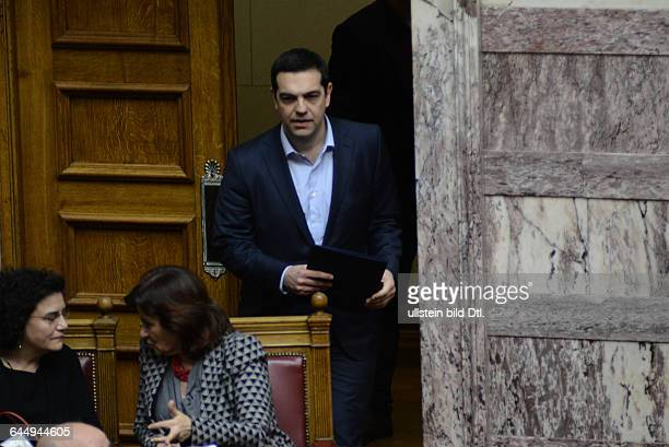Prime Minister Alexis Tsipras arriving in the parliament hall