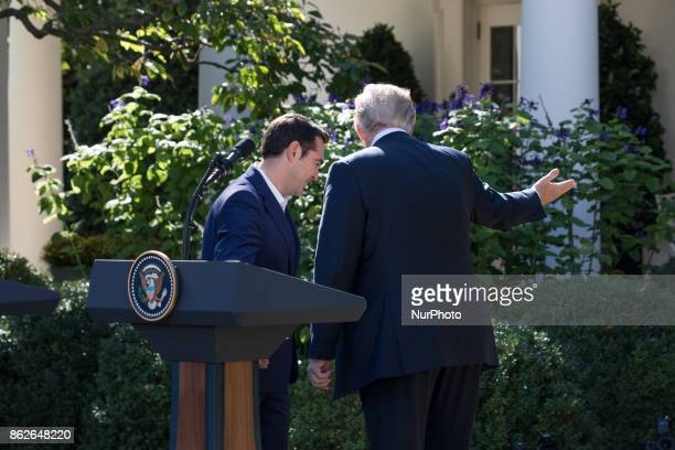 Prime Minister Alexis Tsipras of Greece and US President Donald Trump leave the Rose Garden as they head to the Oval Office of the White House after...