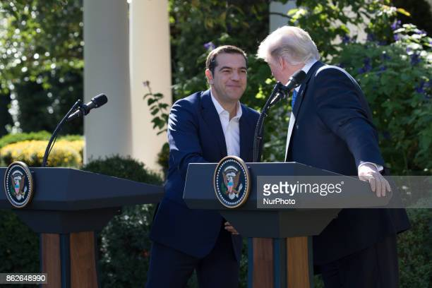 Prime Minister Alexis Tsipras of Greece and US President Donald Trump shake hands during their joint press conference in the Rose Garden of the White...