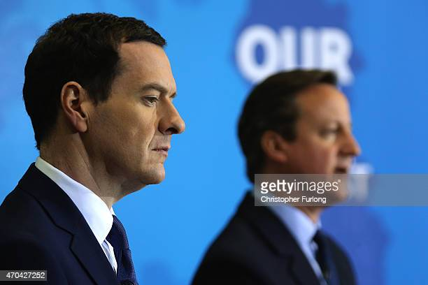 Prime Minister and leader of the Conservative Party David Cameron and Chancellor George Osborne address guests and supporters during a visit to...