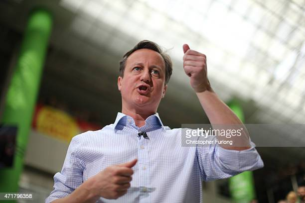 Prime Minister and leader of the conservatives David Cameron gestures as he addresses workers at the head office of supermarket giant Asda on May 1...