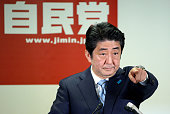 Prime Minister and ruling Liberal Democratic Party president Shinzo Abe attends a press conference on the election result at the LDP headquarters on...