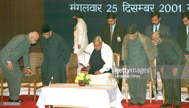 Prime Minister Atal Bihari Vajpayee along with Former Prime Ministers of India VP Singh PV Narasimha Rao IK Gujral at a Kavi Sammellan on December 25...