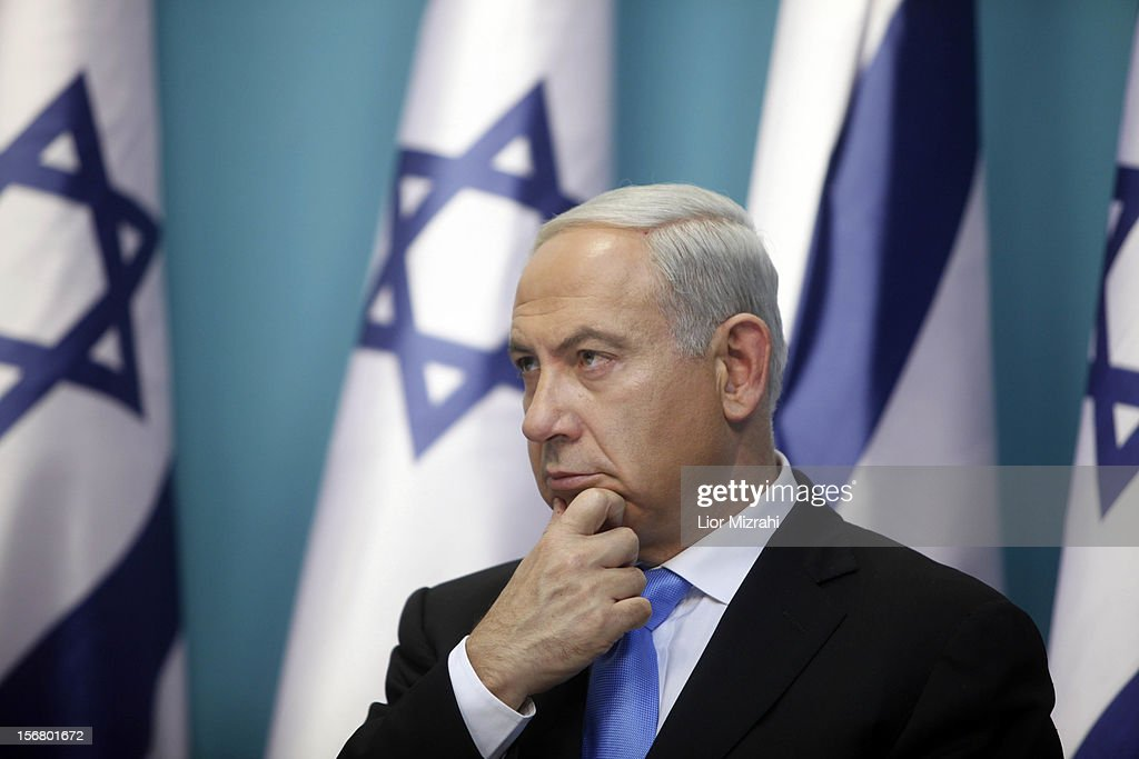 Prime Minister <a gi-track='captionPersonalityLinkClicked' href=/galleries/search?phrase=Benjamin+Netanyahu&family=editorial&specificpeople=118594 ng-click='$event.stopPropagation()'>Benjamin Netanyahu</a> delivers a speech during a joint press conference with Foreign Minister Avigdor Liberman and Defence Minister Ehud Barak (not pictured), on November 21, 2012 in Jerusalem, Israel. An official ceasfire started at 9pm local time between Israel and the Palestinian Hamas movement after eight days of conflict resulting in the deaths of over 140 Palestinians, five Israelis and many hundreds injured.