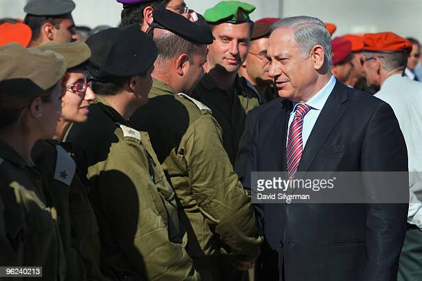 Prime Minister Benjamin Netanyahu greets members of an Israeli military aid mission during a welcoming ceremony for them on their arrival January 28...