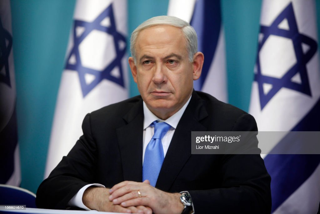 Prime Minister Benjamin Netanyahu looks on during a joint press conference with Foreign Minister Avigdor Liberman and Defence Minister Ehud Barak (not pictured), on November 21, 2012 in Jerusalem, Israel. An official ceasfire started at 9pm local time between Israel and the Palestinian Hamas movement after eight days of conflict resulting in the deaths of over 140 Palestinians, five Israelis and many hundreds injured.