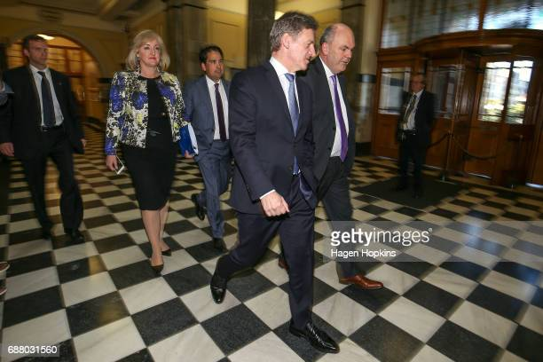 Prime Minister Bill English and Finance Minister Steven Joyce make their way to the house before the 2017 budget presentation at Parliament on May 25...