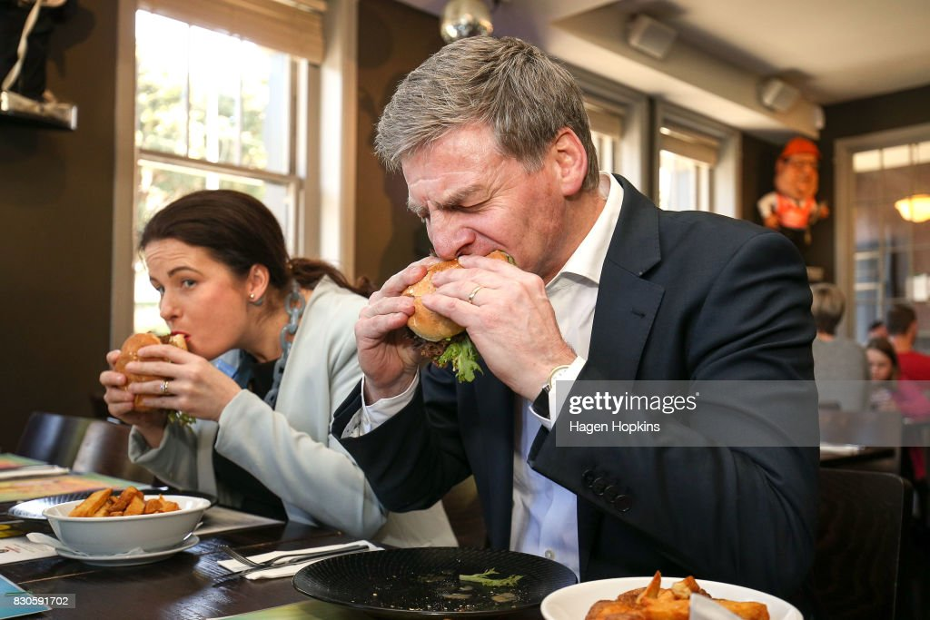 Prime Minister Bill English and Wellington Central candidate Nicola Willis taste test the 'Bill English Burger' at The Backbencher gastropub on August 12, 2017 in Wellington, New Zealand. Prime Minister Bill English is only just ahead as preferred prime minister, with Labour's new leader Jacinda Ardern 1.4 points behind. Labour has enjoyed a surge in support in the last week, following Jacinda Ardern taking over from Andrew Little as party leader on 1 August.