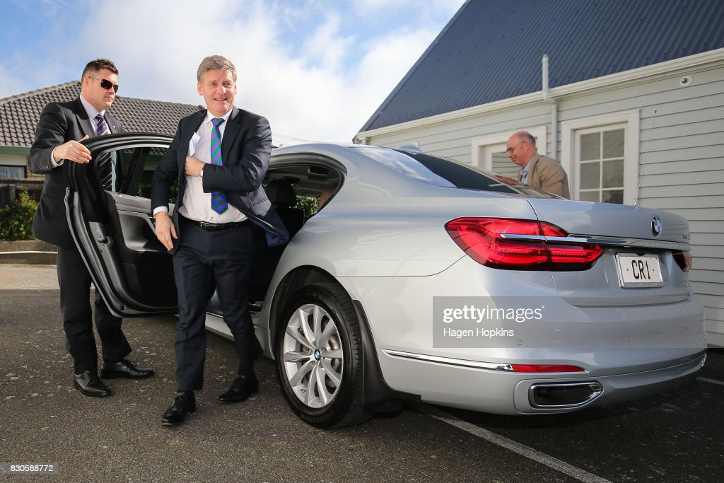 Prime Minister Bill English arrives in his crown car during the opening of a new Challenge 2000 premises on August 12, 2017 in Wellington, New Zealand. Prime Minister Bill English is only just ahead as preferred prime minister, with Labour's new leader Jacinda Ardern 1.4 points behind. Labour has enjoyed a surge in support in the last week, following Jacinda Ardern taking over from Andrew Little as party leader on 1 August.