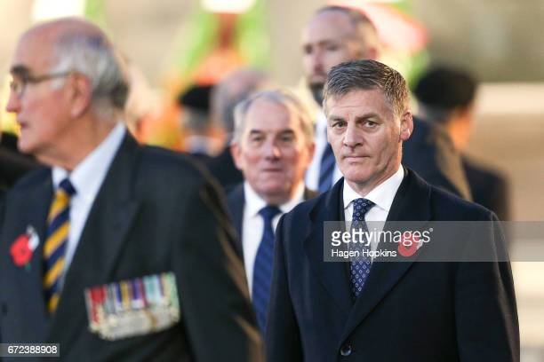 Prime Minister Bill English looks on during Anzac Day dawn service at Pukeahu National War Memorial Park on April 25 2017 in Wellington New Zealand...