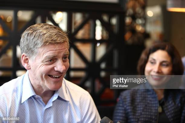 Prime Minister Bill English speaks to the media alongside his wife Mary English at the Pullman Hotel on September 23 2017 in Auckland New Zealand...