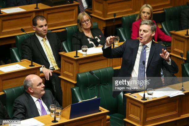 Prime Minister Bill English speaks while Finance Minister Steven Joyce looks on during the 2017 budget presentation at Parliament on May 25 2017 in...