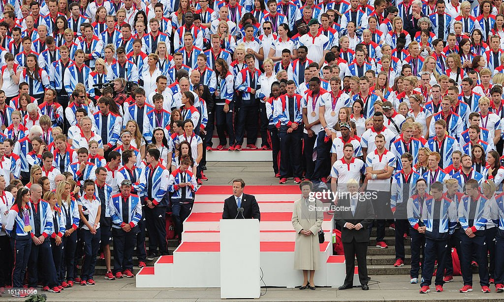 Prime Minister <a gi-track='captionPersonalityLinkClicked' href=/galleries/search?phrase=David+Cameron+-+Politician&family=editorial&specificpeople=227076 ng-click='$event.stopPropagation()'>David Cameron</a> addresses the athletes and fans from the QVM during the Olympics & Paralympics Team GB London 2012 Victory Parade on September 10, 2012 in London, England.
