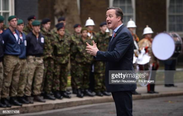 Prime Minister David Cameron addresses veteran and serving Royal Marines in Downing Street central London after a team of Royal Marineacircs Charity...