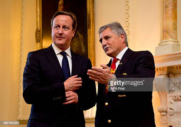 Prime Minister David Cameron and British Lions Tour Manager Andy Irvine attend an official reception at Downing Street on September 16 2013 in London...
