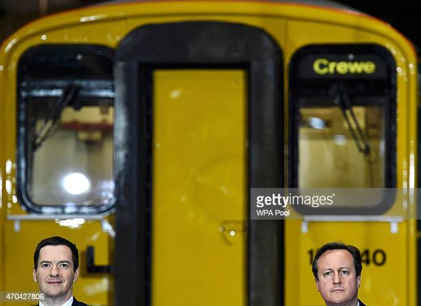 Prime Minister David Cameron and Chancellor of the Exchequer George Osborne address guests during a visit to Arriva TrainCare mantenance plant in...