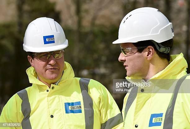 Prime Minister David Cameron and Chancellor of the Exchequer George Osborne tour the Heysham to M6 link road motorway construction site during...